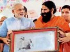 baba ramdev praises narendra modi as they share stage in haridwar